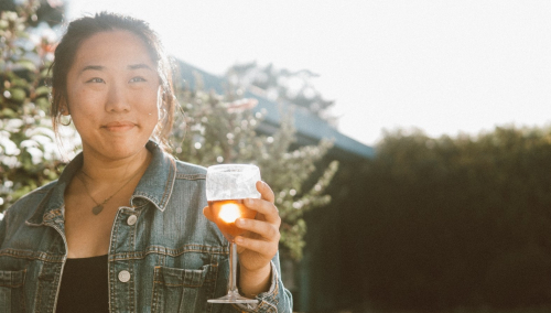 Photo of woman holding a wine glass