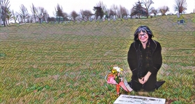 the author at her birth father's grave